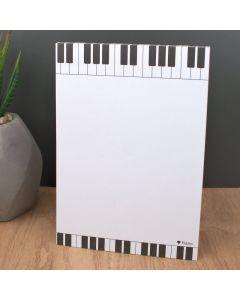 Bloc de notas encolado medida A6 con decoración musical de piano